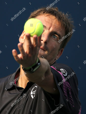 Tommy Robredo, of Spain, serves against Michael Berrer, of Germany, during the first round of the U.S. Open tennis tournament, in New York