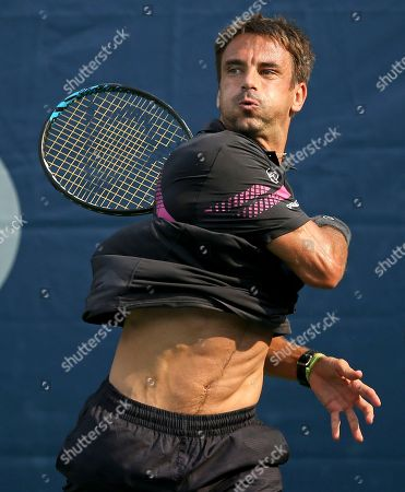 Tommy Robredo, of Spain, returns a shot against Michael Berrer, of Germany, during the first round of the U.S. Open tennis tournament, in New York