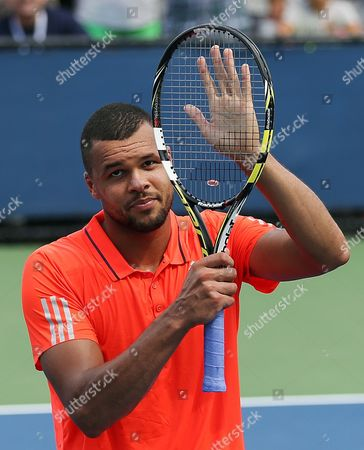 Jo-Wilifried Tsonga, of France, acknowledges applause from the crowd after beating Jarkko Nieminen, of Finland, during the first round of the U.S. Open tennis tournament, in New York