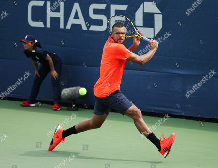 Jo-Wilifried Tsonga, of France, returns a shot against Jarkko Nieminen, of Finland, during the first round of the U.S. Open tennis tournament, in New York