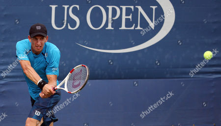 Jarkko Nieminen, of Finland, returns a shot to Jo-Wilifried Tsonga, of France, during the first round of the U.S. Open tennis tournament, in New York