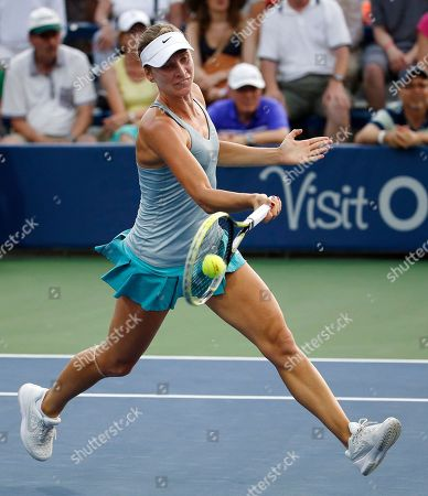 Sesil Karatantcheva Sesil Karatantcheva, of Bulgaria, returns a shot to Belinda Bencic, of Switzerland, during the first round of the U.S. Open Tennis tournament in New York