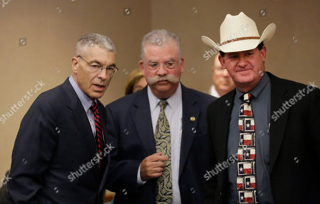 "Steve McCraw, A.J. ""Andy"" Louderback, T. Michael O'Connor Texas Department of Public Safety Deputy Director Steve McCraw, left, talks with Victoria County Sheriff T. Michael O'Connor, center, and Jackson County Sheriff A.J. ""Andy"" Louderback, right, before the Texas County Affairs Committee hearing to discuss jail standards, in Austin, Texas. The hearing is the first time lawmakers are meeting to discuss the circumstances surrounding the death of Sandra Bland. Authorities say Bland hanged herself in jail on July 13, a finding that her family has questioned"