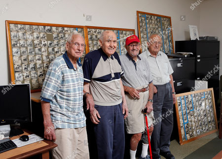 "Stock Image of Felix Farina, Christopher Sgambati, Francis ""Dick"" Varone and Anthony Luciano World War II veterans Felix Farina, Christopher Sgambati, Francis ""Dick"" Varone and Anthony Luciano pose for a photo at the Mechanicville Public Library near photos of servicemen, themselves included, taken by Charles Siciliano at his Mechanicville bar during the war. The quality, size and longevity of the Siciliano collection make it ""completely unique"" among known WWII collections, according to Kimberly Guise, a curator at the National World War II Museum in New Orleans"