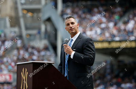 Andy Pettitte Retired New York Yankees pitcher Andy Pettitte speaks during a pregame ceremony officially retiring his number before a baseball game in New York, . The Yankees will install a monument honoring Pettitte in Monument Park