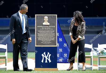 Andy Pettitte Retired New York Yankees pitcher Andy Pettitte, left, and his wife Laura admire a plaque dedicted to Pettitte during a pregame ceremony retiring his number 46 before a baseball game in New York, . The Yankees will install the plaque in Monument Park
