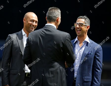 Derek Jeter, Andy Pettitte, Jorge Posada Retired New York Yankees shortstop Derek Jeter, left, and catcher Jorge Posada, right, greet former pitcher Andy Pettitte during a ceremony retiring Pettitte's No. 46 before a baseball game in New York, . The Yankees will install a monument honoring Pettitte in Monument Park