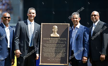 Mariano Rivera, Andy Pettitte, Jorge Posada, Bernie Williams Retired New York Yankees players, from left, Mariano Rivera, Andy Pettitte, Jorge Posada and Bernie Williams pose with Pettitte' plaque for Monument Park during a pregame ceremony officially retiring his number before a baseball game in New York, . Posada's number 20 was retired Saturday