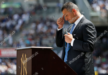 Andy Pettitte Retired New York Yankees pitcher Andy Pettitte pauses during his remarks during a pregame ceremony retiring Pettitte's number before a baseball game in New York