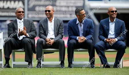 Bernie Williams, Derek Jeter, Jorge Posada, Mariano Rivera From left, retired New York Yankees Bernie Williams, Derek Jeter, Jorge Posada and Mariano Rivera listen as retired Yankees pitcher Andy Pettitte speaks during a ceremony officially retiring his number before a baseball game in New York