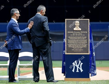 Jorge Posada, Andy Pettitte Former New York Yankees catcher Jorge Posada, left, puts his hand on former Yankees pitcher Andy Pettitte's back as Pettitte looks at a plaque dedicated to him, before the Yankees' baseball game against the Cleveland Indians in New York, . The plaque will be installed in Yankee Stadium's Monument Park