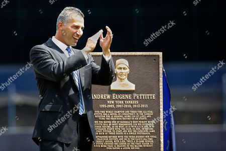 Andy Pettitte Retired New York Yankees pitcher Andy Pettitte reacts during a pregame ceremony retiring his number before a baseball game in New York, . The plaque beside Pettitte will be placed in Yankee Stadium's Monument Park