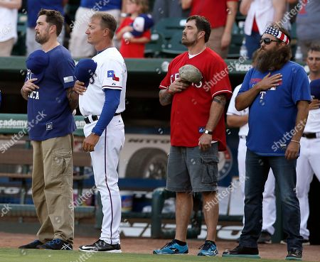 Marcus Luttrell, Jeff Banister, Morgan Luttrell, Willie Robertson Former Navy Seal Marcus Luttrell, from left, Texas Rangers manager Jeff Banister, former Navy Seal Morgan Luttrell and CEO of Duck Commander Willie Robertson, right, stand during the playing of the national anthem before a baseball game against the New York Yankees, in Arlington, Texas