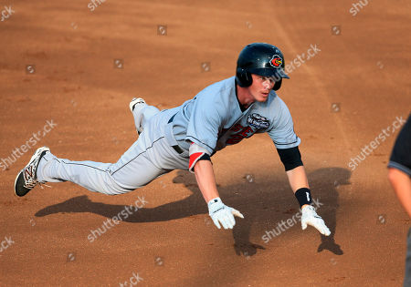 James Beresford International team second baseman James Beresford dives into third with a triple during the first inning of the Triple-A All-Star baseball game in Papillion, Neb