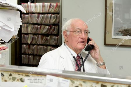"""Jack Lewis Eighty-year-old practicing physician Dr. Jack Lewis uses a telephone in his office in Omaha, Neb., . Lewis has worked as an internal medicine specialist for half a century _ first with his dad, who worked until age 83, and now with his 41-year-old physician son. """"My dad always told me to watch to see if he was making mistakes or losing it, and my son is watching me the same way,"""" Lewis said. A new report by an American Medical Association council says doctors themselves should decide when one of their own needs to stop working"""