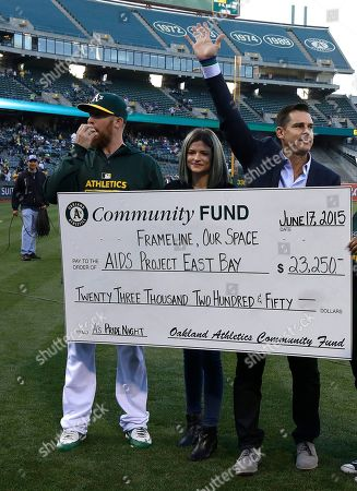 Sean Doolittle, Eireann Dolan, Billy Bean From left, Oakland Athletics' Sean Doolittle, Eireann Dolan, and Billy Bean, MLB Ambassador for Inclusion, stand on the field during pride night prior to the baseball game against the San Diego Padres, in Oakland, Calif