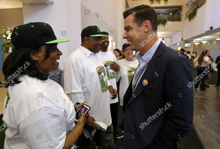 Billy Bean, Carol Williams Billy Bean, right, MLB Ambassador for Inclusion, meets with Carol Williams, sister of Glenn Burke, prior to the baseball game between the San Diego Padres and the Oakland Athletics, in Oakland, Calif