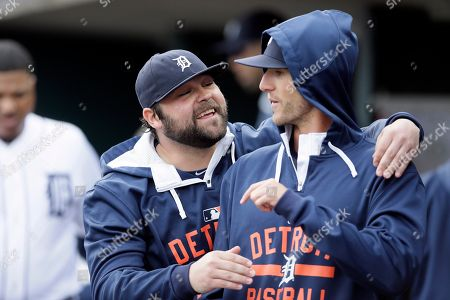 Joba Chamberlain, Shane Greene Detroit Tigers relief pitcher Joba Chamberlain, left, and pitcher Shane Greene are seen in the dugout before the first inning of a baseball game against the Oakland Athletics, in Detroit