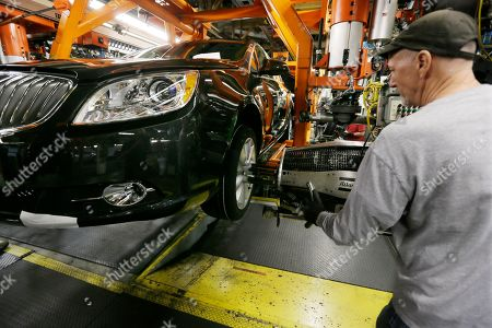 United Auto Workers assemblyman Bill Duke tightens lug nuts on a Buick Verano at General Motors' Orion Assembly plant in Orion Township, Mich. Preserving jobs, pay raises, cost cuts are all on the table as Detroit automakers open talks with UAW beginning July 13, 2015