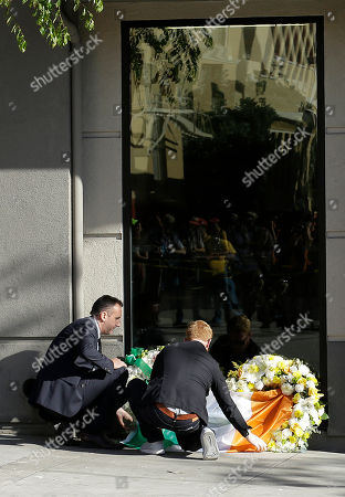 Philip Grant Philip Grant, Consul General of Ireland of the Western United States, left, and Neil Sands of the Irish Network Bay Area place a flag of Ireland over wreaths at the Library Gardens apartment complex in Berkeley, Calif., . Berkeley police say several people are dead and others injured after a balcony fell shortly before 1 a.m., near the University of California, Berkeley