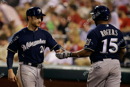 Jonathan Lucroy, Jason Rogers Milwaukee Brewers' Jonathan Lucroy, left, celebrates with Jason Rogers after Lucroy scored on the go-ahead RBI-single by Adam Lind during the 11th inning of a baseball game against the Philadelphia Phillies, in Philadelphia. Milwaukee won 8-7