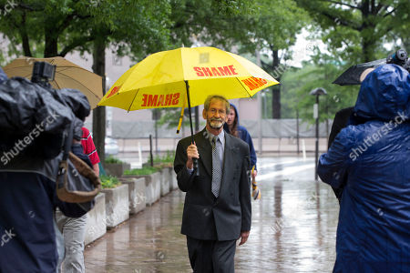 """Doug Hughes Carrying an umbrella that says """"shame"""" on it, Douglas Hughes of Florida leaves federal court in Washington, . Hughes, who flew a gyrocopter through some of America's most restricted airspace before landing at the Capitol pleaded not guilty on Thursday to the six charges he faces"""