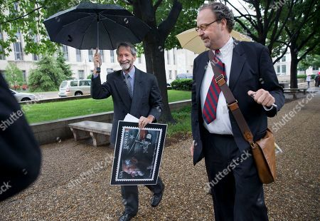Doug Hughes Douglas Hughes of Florida, left, leaves federal court in Washington, holding a design for a stamp that was given to him as a gift. Hughes, who flew a gyrocopter through some of America's most restricted airspace before landing at the Capitol pleaded not guilty on Thursday to the six charges he faces