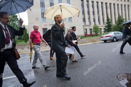 Doug Hughes Douglas Hughes of Florida, center, leaves federal court in Washington, . Hughes, who flew a gyrocopter through some of America's most restricted airspace before landing at the Capitol pleaded not guilty on Thursday to the six charges he faces