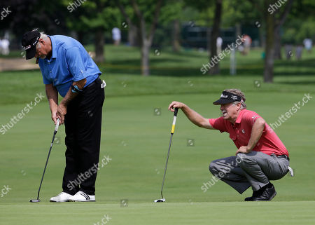 Stock Image of Michael Allen, right, and John Jacobs on the18th green during the first round of the Encompass Championship golf tournament, in Glenview, Ill