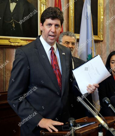 Steven Dettelbach U.S. Attorney Steven Dettelbach holds up the settlement agreement with the City of Cleveland as he speaks at a news conference, in Cleveland. Cleveland agreed to overhaul its police department under the supervision of a federal monitor in a settlement announced Tuesday with the U.S. Department of Justice over a pattern of excessive force and other abuses by officers. The announcement comes three days after a white patrolman was acquitted of voluntary manslaughter charges in the shooting deaths of two unarmed black suspects in a 137-shot barrage of police gunfire following a high-speed chase. The case helped prompt an 18-month investigation by the Justice Department
