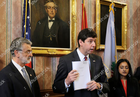 Steven Dettelbach, Frank Jackson, Vanita Gupta U.S. Attorney Steven Dettelbach, center, holds up the settlement agreement with the City of Cleveland as he speaks at a news conference, in Cleveland. Cleveland agreed to overhaul its police department under the supervision of a federal monitor in a settlement announced Tuesday with the U.S. Department of Justice over a pattern of excessive force and other abuses by officers. The announcement comes three days after a white patrolman was acquitted of voluntary manslaughter charges in the shooting deaths of two unarmed black suspects in a 137-shot barrage of police gunfire following a high-speed chase. The case helped prompt an 18-month investigation by the Justice Department. Cleveland Mayor Frank Jackson, left, and Vanita Gupta, head of civil rights division at the Department of Justice, right, listen