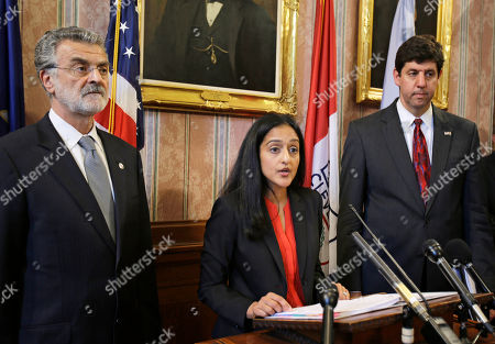 Vanita Gupta, Steven Dettelbach, Frank Jackson Vanita Gupta, head of civil rights division at the Department of Justice, center, speaks at a news conference announcing the settlement agreement with the City of Cleveland, in Cleveland. Cleveland agreed to overhaul its police department under the supervision of a federal monitor in a settlement announced Tuesday with the U.S. Department of Justice over a pattern of excessive force and other abuses by officers. The announcement comes three days after a white patrolman was acquitted of voluntary manslaughter charges in the shooting deaths of two unarmed black suspects in a 137-shot barrage of police gunfire following a high-speed chase. The case helped prompt an 18-month investigation by the Justice Department. Cleveland Mayor Frank Jackson, left, and U.S. Attorney Steven Dettelbach, right, listen