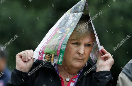 Pam Anderson Pam Anderson of Fort Worth, Texas, tries to stay dry in the rain while watching the first round of the Colonial golf tournament, in Fort Worth, Texas