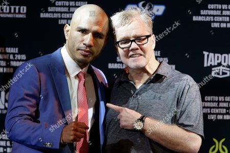 Miguel Cotto, Freddie Roach Boxer Miguel Cotto, left, poses for photographers with his trainer Freddie Roach during a news conference, in New York. Cotto is slated to defend his WBC world middleweight title against Daniel Geale on Saturday, June 6, at Barclays Center in the Brooklyn borough of New York