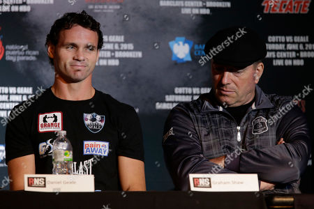 Daniel Geale, Graham Shaw Boxer Daniel Geale, left, is seated next to his trainer Graham Shaw during a news conference, in New York. Miguel Cotto is slated to defend his WBC world middleweight title against Geale on Saturday, June 6, at Barclays Center in the Brooklyn borough of New York