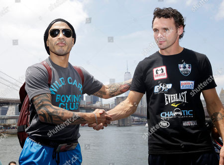 Miguel Cotto, Daniel Geale Boxers Miguel Cotto, left, and Daniel Geale pose for a picture in front of the lower Manhattan skyline in the Brooklyn borough of New York, . Cotto is slated to defend his middleweight title against Geale on Saturday, June 6, at Barclays Center in the Brooklyn