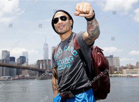 Miguel Cotto Boxer Miguel Cotto poses for a picture in front of the lower Manhattan skyline in the Brooklyn borough of New York, . Cotto is slated to defend his WBC world middleweight title against Daniel Geale on Saturday, June 6, at Barclays Center in the Brooklyn