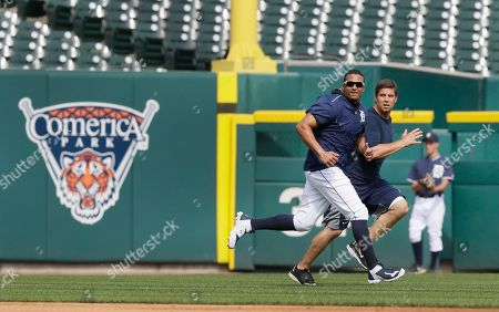 Chris McDonald, Victor Martinez Detroit Tigers' Victor Martinez runs sprints with Chris McDonald, team strength and conditioning coach during batting practice before a baseball game against the Chicago Cubs, in Detroit. The injured designated hitter will be with the team for the foreseeable future as he works his way back on the field from left knee inflammation. Martinez said he feels good, a lot better than when he was placed on the 15-day disabled list May 19, when the Tigers determined it was time to stop trotting him out on a thrice-surgically repaired left knee