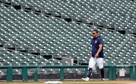 Stock Picture of Victor Martinez Detroit Tigers' Victor Martinez walks back to the dugout after running sprints with Chris McDonald, team strength and conditioning coach during batting practice before a baseball game against the Chicago Cubs, in Detroit. The injured designated hitter will be with the team for the foreseeable future as he works his way back on the field from left knee inflammation