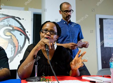Stock Picture of Haitian-American writer Edwidge Danticat speaks as Dominican-American writer Junot Diaz, stands by during a gathering of about 150 activists and community members in Miami on . The group called for political pressure, travel boycotts and consumer choices over items such as sugar to strip power from the governments and corporations benefiting from a policy that they say targets black migrants. Haiti and the Dominican Republic share the island of Hispaniola, but the countries have long had an uneasy relationship. The Dominican government says it will deport non-citizens who didn't submit applications to establish legal residency before a June 17 deadline