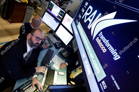 Peter Giacchi Specialist Peter Giacchi works at the post that handles Reynolds American, on the floor of the New York Stock Exchange, . Reynolds American, the company behind Camel and Pall Mall cigarettes, said its $25 billion deal to buy rival Lorillard will be completed on Friday