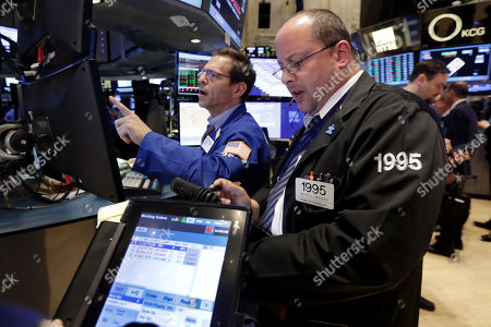 Charles Solomon, Jeffrey Vazquez Specialist Charles Solomon, left, and trader Jeffrey Vazquez work on the floor of the New York Stock Exchange at the closing bell, . U.S. stocks closed slightly lower as a slump in utilities offsets a gain in energy stocks