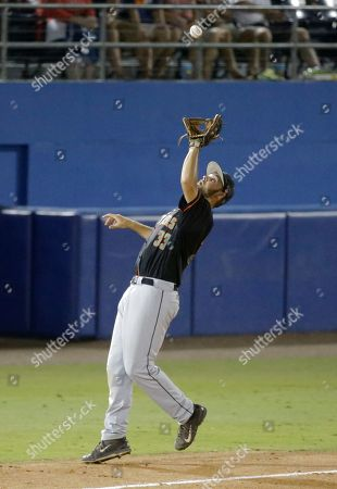 Florida A&M's Ryan Kennedy catches a pop fly against Florida during a game at the Gainesville Regional of the NCAA college baseball tournament, in Gainesville, Fla. Florida won 19-0