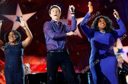 Michelle Brooks-Thompson, Melinda Doolittle, Michael Cavanaugh Michael Cavanaugh, center, performs with Melinda Doolittle, left, and Michelle Brooks-Thompson during rehearsal for the annual Boston Pops orchestra Fourth of July concert at the Hatch Shell in Boston