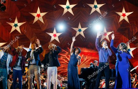 Melinda Doolittle, Michelle Brooks-Thompson, Michael Cavanaugh From right to left, performers Michelle Brooks-Thompson, Michael Cavanaugh, Melinda Doolittle and members of Sons of Serendip take lead a sing-along during rehearsal for the annual Boston Pops orchestra Fourth of July concert at the Hatch Shell in Boston