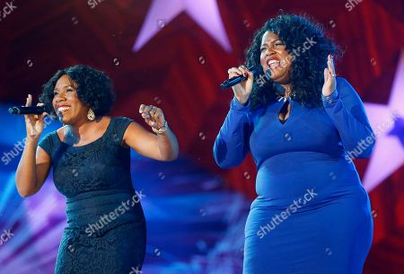 Melinda Doolittle, Michelle Brooks-Thompson Melinda Doolittle, left, and Michelle Brooks-Thompson perform during rehearsal for the annual Boston Pops orchestra Fourth of July concert at the Hatch Shell in Boston
