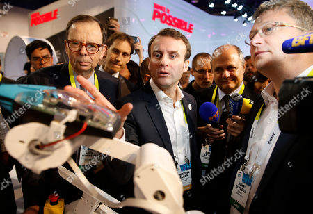 Emmanuel Macron, Henri Seydoux, Louis Schweitzer French finance minister Emmanuel Macron, center, tours the Parrot booth with Parrot CEO and founder Henri Seydoux, right, and Louis Schweitzer, left, at the International CES in Las Vegas. France's economy minister is heading to the U.S. to urge more American companies to invest in France, as he tries to reform a country with a reputation for strikes and high labor costs