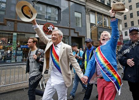 Sir Ian McKellan, Derek Jacobi Grand Marshals Sir Ian McKellan, left, and Sir Derek Jacobi, right, wave their hats as they walk hand-in-hand down Fifth Avenue during the Heritage Pride March in New York, . A large turnout was expected for gay pride parades across the U.S. following the landmark Supreme Court ruling that said gay couples can marry anywhere in the country