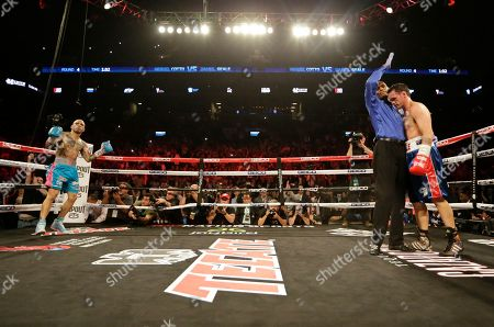 Miguel Cotto Miguel Cotto, left, of Puerto Rico, celebrates after defeating Daniel Geale, of Australia, during the fourth round of a boxing match, in New York