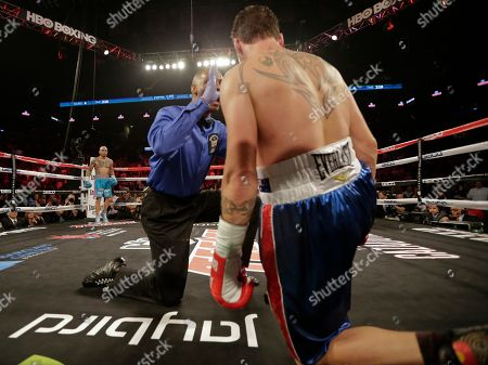 Stock Image of Miguel Cotto Miguel Cotto, of Puerto Rico, waits as the referee counts for Daniel Geale, of Australia, who was knocked down during the fourth round of a boxing match, in New York